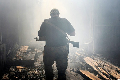 Mstislav Chernov/AP // A Pro-Russian rebel walks in a passage at the local market damaged by shelling in Petrovskiy district in the town of Donetsk, eastern Ukraine, Aug. 26, 2014.