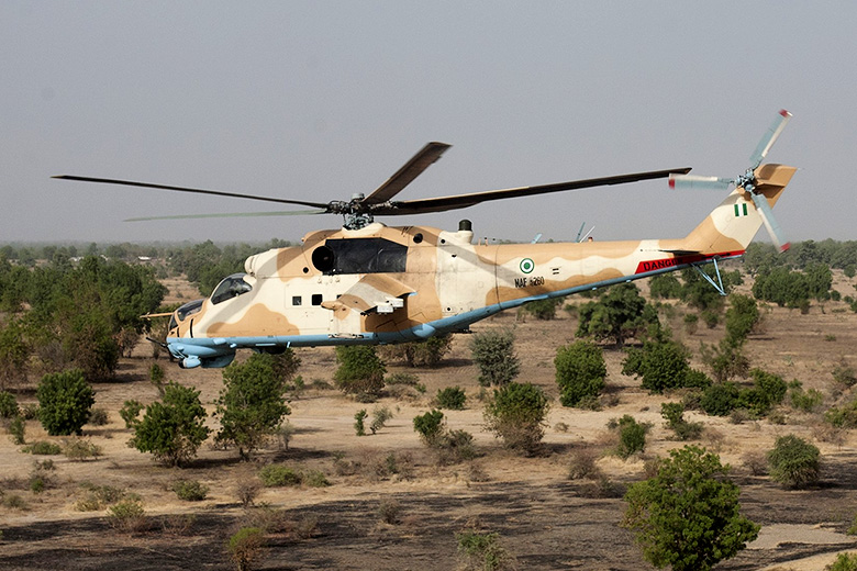 Jane Hahn/Washington Post // A Nigerian military helicopter flies over northern Nigeria.