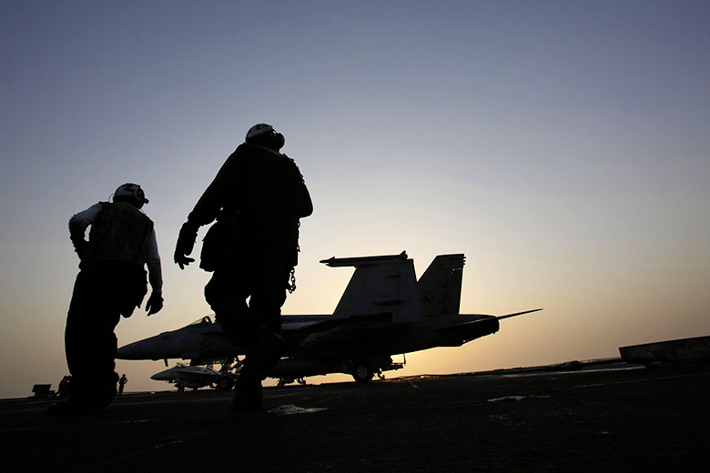 Hasan Jamali/Associated Press  // US sailors work on aircraft for missions targeting ISIS in Iraq.