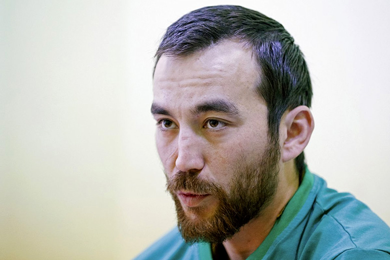 Reuters // A man, according to Ukraine's state security service (SBU) named Yevgeny Yerofeyev, who is one of two Russian servicemen recently detained by Ukrainian forces, during an interview with Reuters at a hospital in Kiev, Ukraine, on Thursday.
