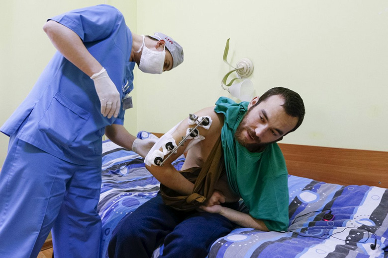 Reuters // Yerofeyev being examined by a medic at a hospital in Kiev, Ukraine, on Thursday.