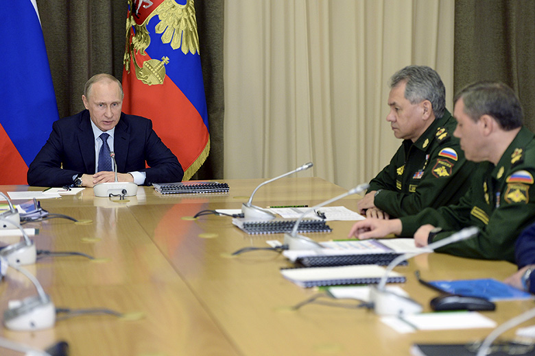 Reuters // Russian President Vladimir Putin with senior officials of the Defense Ministry and representatives of the military industrial complex at the Bocharov Ruchei state residence in Sochi on May 12.