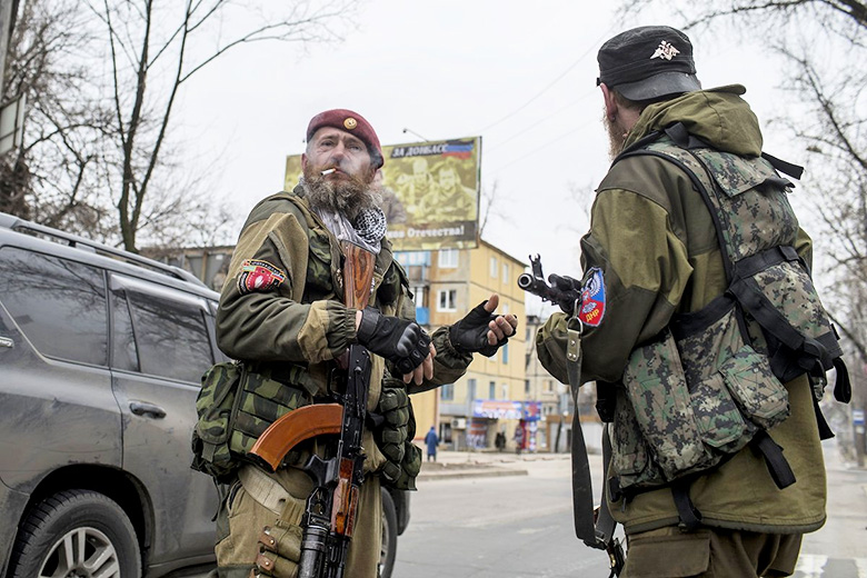 Reuters // Pro-Russian rebels taking positions on a street during what the rebels said was an anti-terrorist drill in Donetsk on March 18.