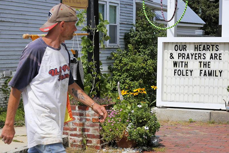 Brian Snyder/Reuters // A sign outside a shop remembers James Foley in his hometown of Rochester, NH.