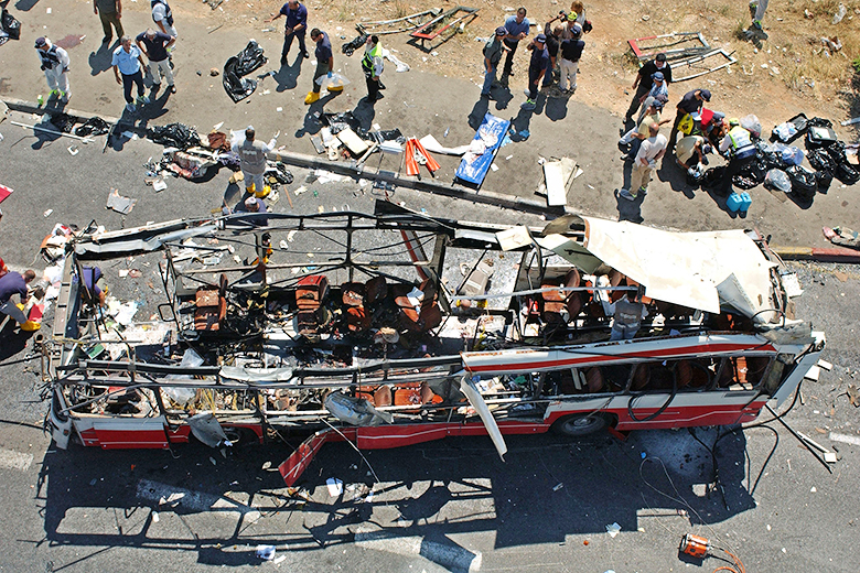 Getty Images // A 2002 Palestinian bus bombing that killed 18 in Jerusalem.