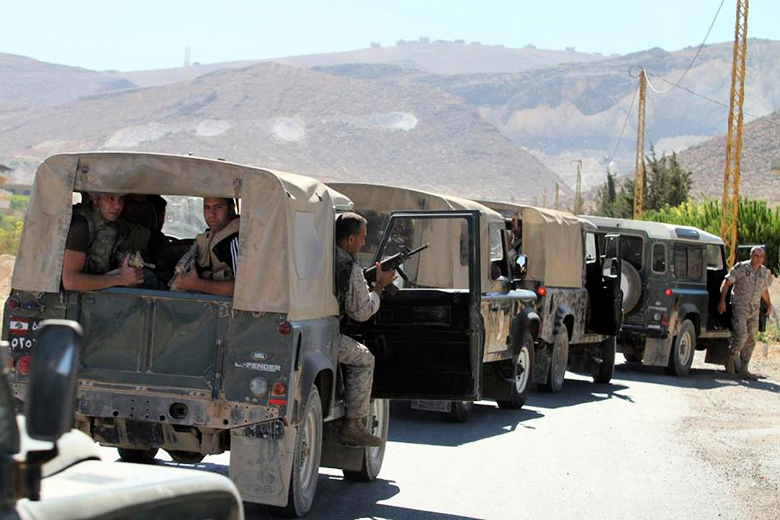 AFP/Getty Images/File // Lebanese army soldiers drive to the entrance of the town of Arsal in the Bekaa valley.