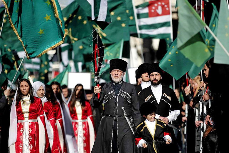 Sedat Suna/EPA // Members of a Circassian ethnic group shout slogans during a protest against the Olympics in front of the Russian Consulate in Istanbul, Feb. 2, 2014.