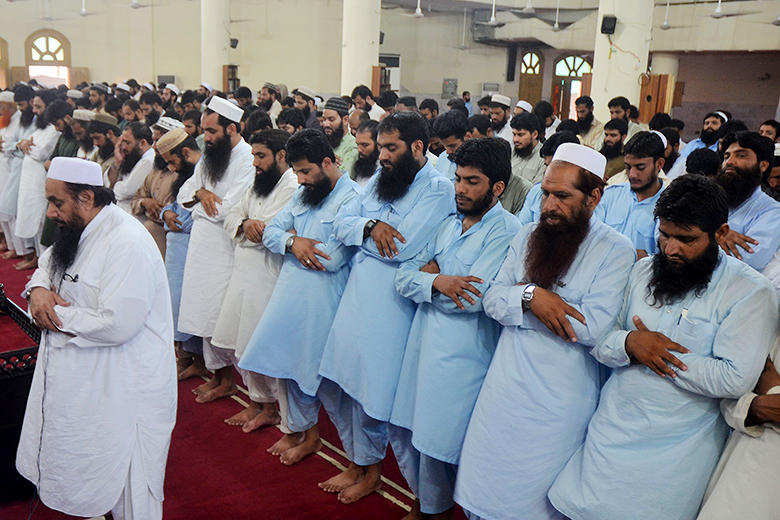 Ahmed Ali/Associated Press // A religious group in Lahore, Pakistan, participated in funeral prayers for Mullah Muhammad Omar.
