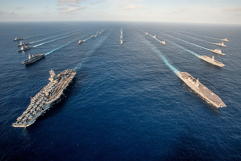 U.S. Navy/Mass Communication Specialist 3rd Class Nathan Burke/Released // The Ronald Reagan Carrier Strike Group (RRNCSG) steams in formation with Japan Maritime Self-Defense Force ships for a photo exercise during Annual Exercise (AE) 16.