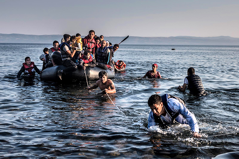 Sergey Ponomarev/The New York Times // Greek Fence Forces Migrants to Sea