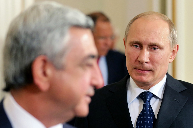Maxim Shipenkov/AFP/Getty Images // Russian President Vladimir Putin talks with Armenian President Serzh Sarkisian, the leader of Russia's most loyal ally in the Caucasus.