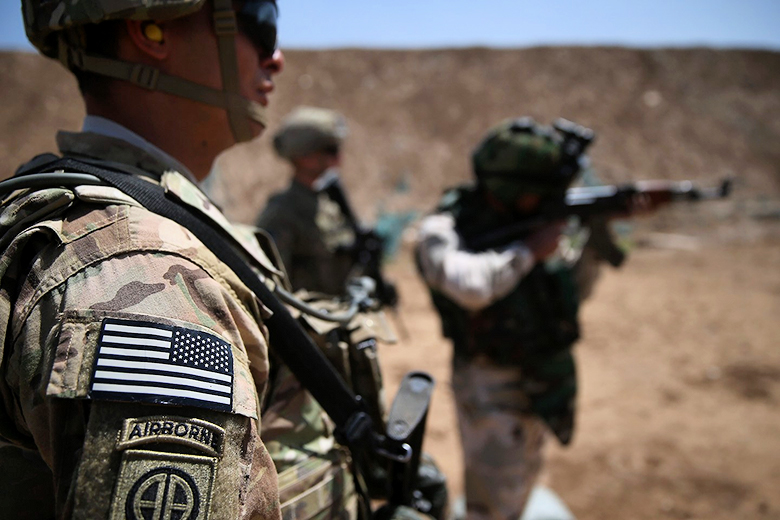 John Moore/Getty Images // U.S. soldiers training the Iraqi army.